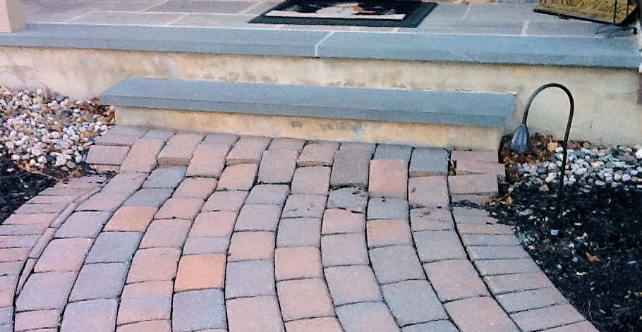walkway pavers damaged and out of place after Winter weather