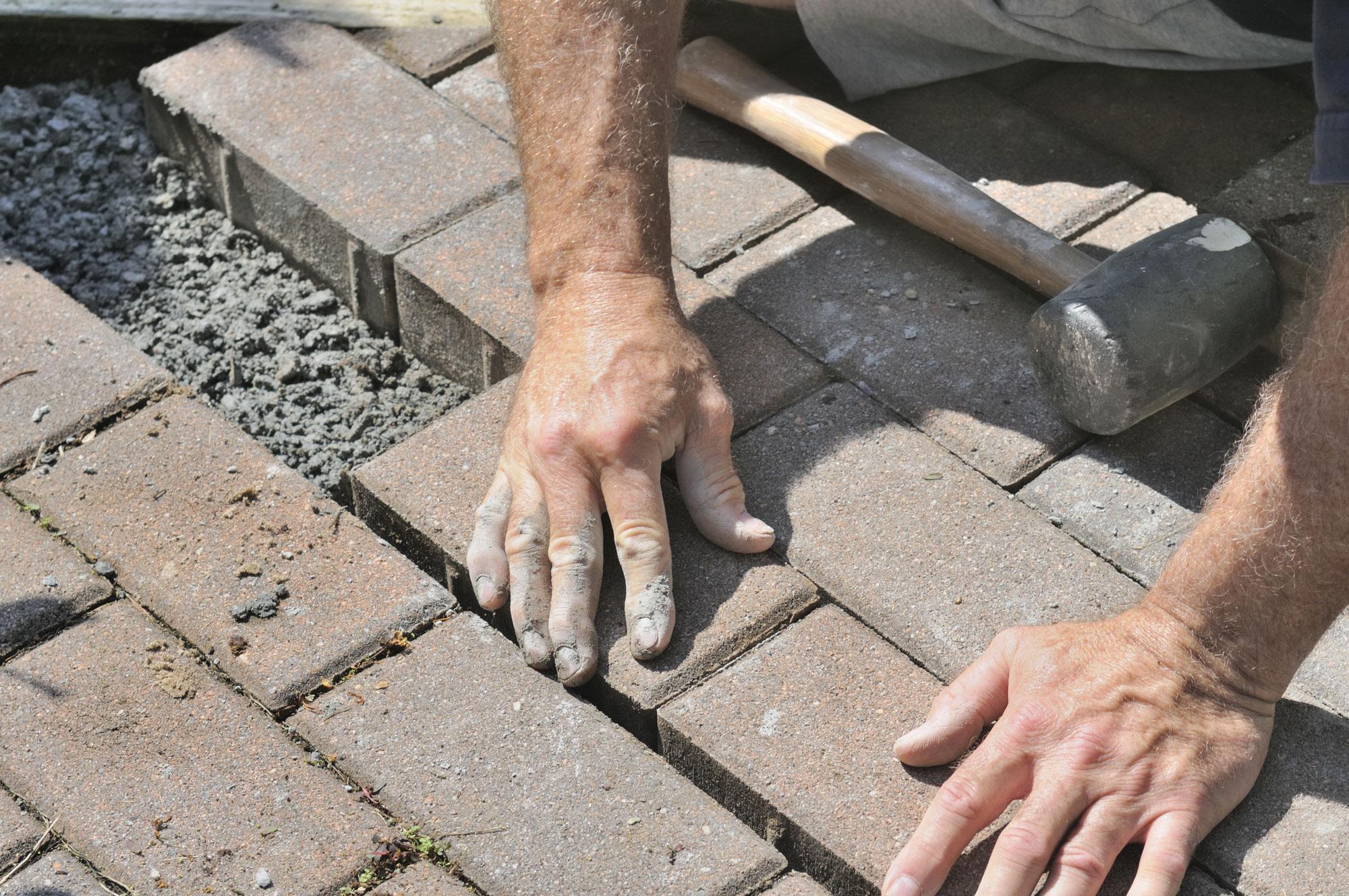 Repair Broken or loose pavers