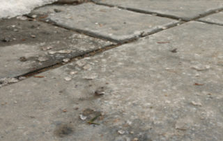 Yes you can use rock salt or ice melt on concrete pavers.